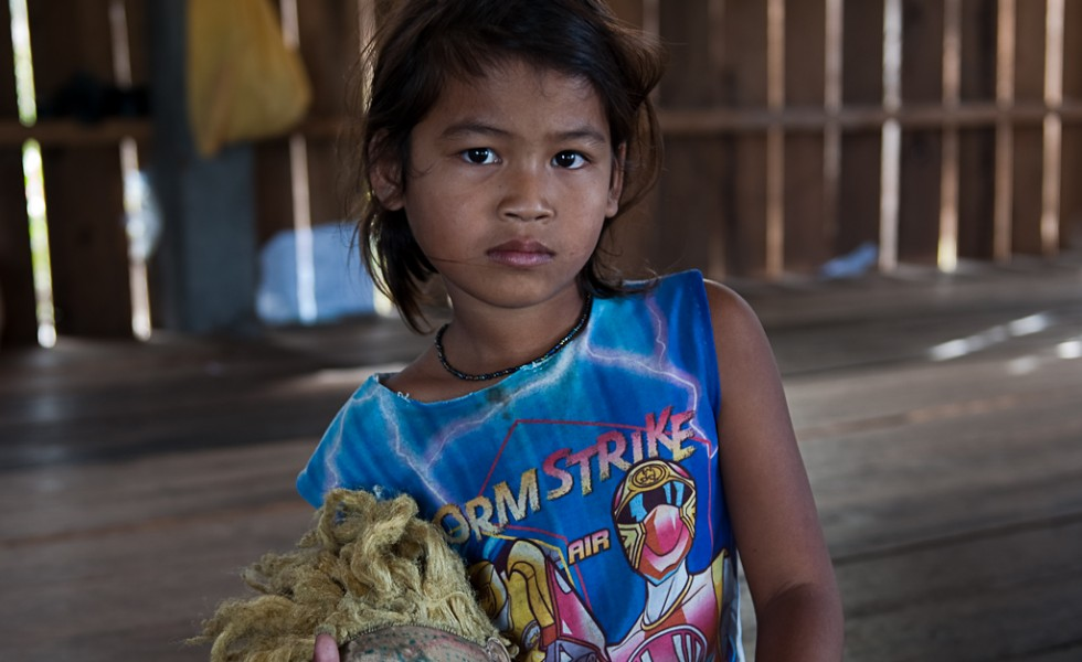 Student at the Tamoung Pha-em primary school, in her house